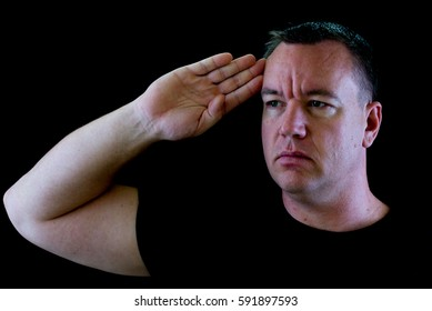 Image of a handsome man, saluting, British style.