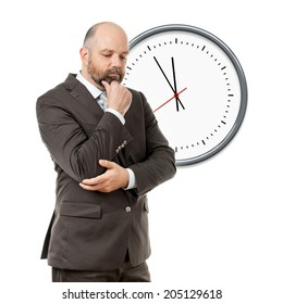 An image of a handsome thinking business man deadline