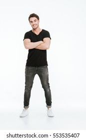 Image of handsome young man dressed in black t-shirt standing with arms crossed over white background.