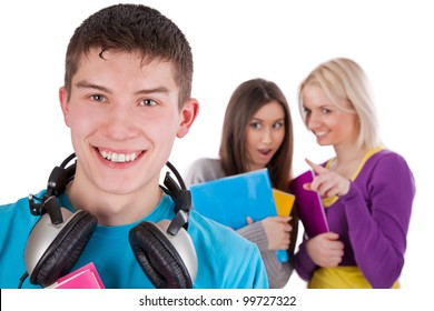 Image of handsome young man with headphones on the bckground of girls