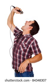 Image of a handsome young man singing to the microphone, isolated on white