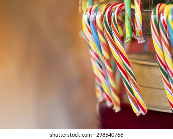 Image with hanging candy canes on a Christmas Market and free space