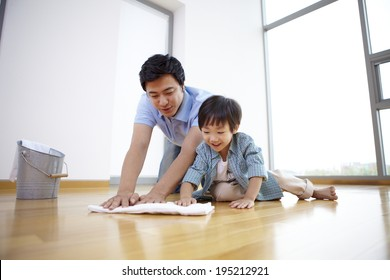 the image of a happy Asian family cleaning the floor