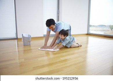 the image of a happy Asian family cleaning floor