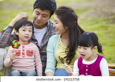 the image of a happy Asian family in the park
