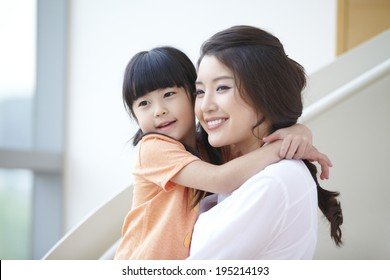 the image of a happy Asian mother and daughter