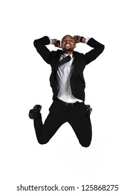 Image of a happy businessman jumping in air over white background