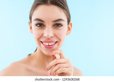 Image of happy cheerful beautiful young woman posing isolated over blue background.