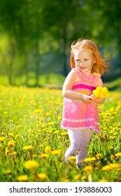 Image of happy child on dandelions field, cheerful little girl resting on dandelions meadow, relaxation outdoor in springtime, vacation.