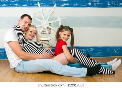 The image of a happy family expecting the second child