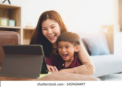 image of happy family at living room,happiness time of family playing at home,Mom and baby are happiness coexistence,happy family concept and Creating activities to strengthen skills for children.