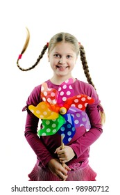 An image of a happy girl with a whirligig in her hands