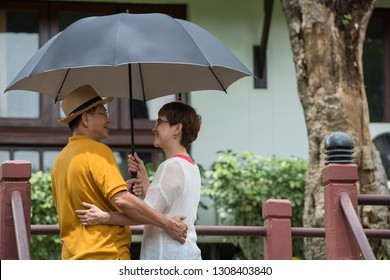 Image of happy romantic Asian senior couple outdoor in park