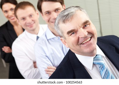Image of a happy senior chief and his team