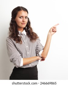Image of happy smiling beautiful young businesswoman showing copyspace over white