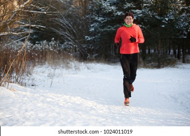 Image of happy sports girl on morning run in winter park