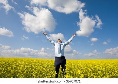 Image of happy winner showing triumph in meadow