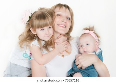The image of the happy woman with two daughters