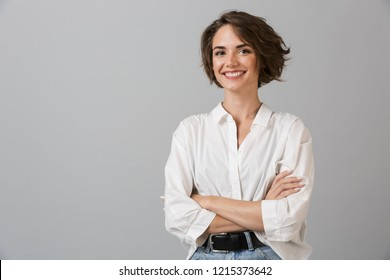 Photo of Image of happy young business woman posing isolated over grey wall background.