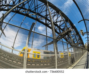 The image of Harbour bridge Structure with the train running through on its track, the image was taken in fish eyes wide angle lens.
