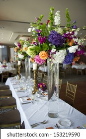 Image of the head table at a wedding with florals