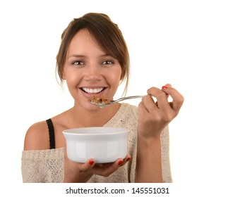 Image of a healthy latino woman eating breakfast