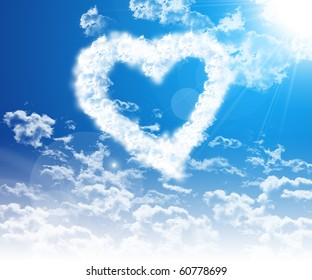 The image of the heart in the blue sky of clouds.
