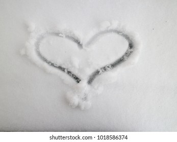 image heart drawn on snow