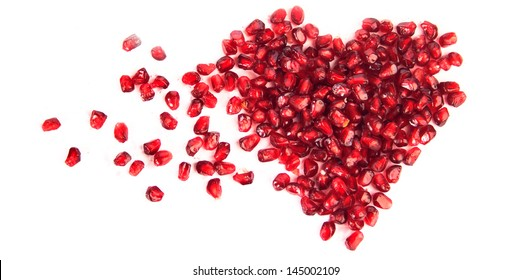 An image of a heart of pomegranate seeds
