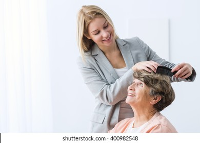Image of helpful woman take care of ill grandmother