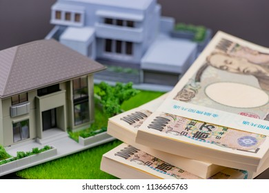 """Image of home purchase. Translation: """"Bank of Japan Tickets"""" """"One hundred thousand yen"""" """"The Bank of Japan"""""""