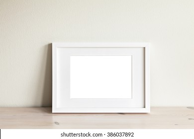 Image of a horizontal white frame mockup.