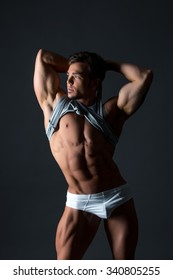 Image of hot blue-eyed bodybuilder shows his body