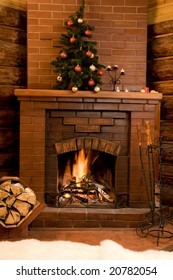 Image of hot fire in chimney with fir tree decorated before Christmas