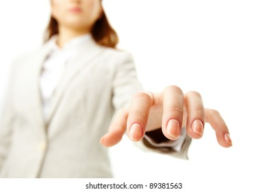 Image of human hand keeping palm down on background of female