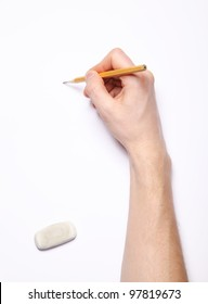 Image of human hand with pencil and eraser on white
