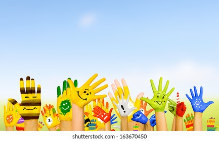 Image of human hands in colorful paint with smiles