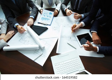 Image of human hands during paperwork at meeting
