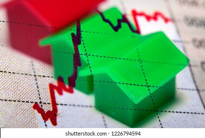 Image illustrating the current housing market and a red stock chart