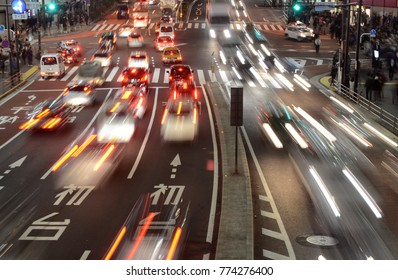 Image illustrating vehicle traffic and fast paced, motion concept of busy congested city street in the Shinjuku area of Tokyo Japan