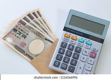 """Image of income and expenditure. Translation: """"Bank of Japan Tickets"""" """"One hundred thousand yen"""" """"The Bank of Japan"""" by Koji Yamamoto"""