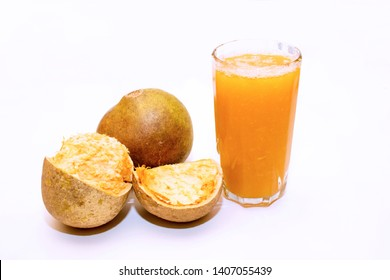 image of Indian bael fruit juice with white background