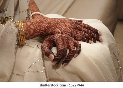 An image of an Indian bride's hands covered in henna