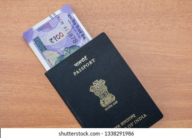 Image of Indian passport and new Indian paper currency.