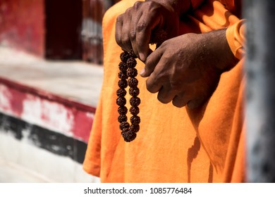 Image of an Indian sadhu sitting in a meditation pose with rudraksha