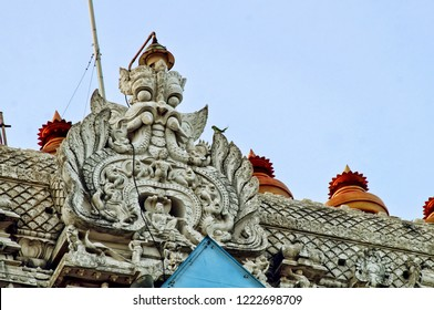 Image of the intricate monster sculptured on the entrance wall(gopuram) of the Lord Muruga temple in the temple town of Thiruchendur,Tamil Nadu,India