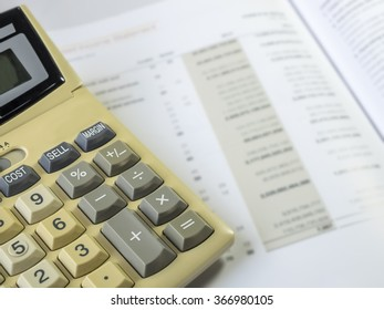 Image of Investment and Financial analysis and reporting concept, Calculator laying on financial performance report.