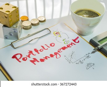 Image of Investment Management. Portfolio Management word on sheet with clipboard, cup of coffee, calculator, pen, coins and dices.