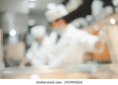 Image of Japan chef making food in kitchen for background usage.