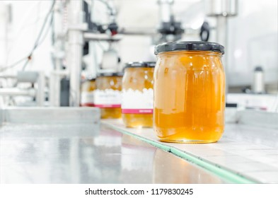 Image of jar full with organic honey, production in factory.